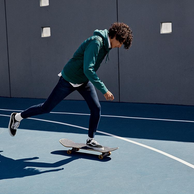 Skateboarder wearing EZY Jeans