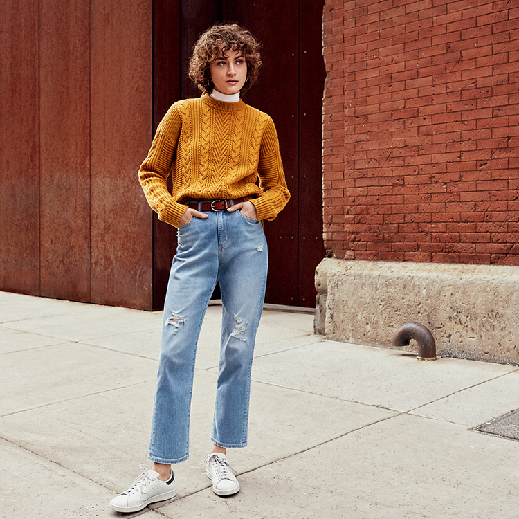 Woman wearing High Rise Straight Ankle Jeans